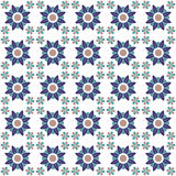 Seamless background image of vintage blue round flower repeat kaleidoscope pattern. Royalty Free Stock Image