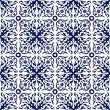 Seamless background image of vintage blue spiral flower vine kaleidoscope pattern. Stock Images