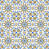 Seamless background image of vintage golden sun blue kaleidoscope pattern. Royalty Free Stock Image