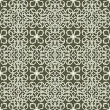 Seamless background image of vintage green lace kaleidoscope spiral pattern. Stock Photos