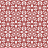Seamless background image of vintage red flower kaleidoscope pattern. Stock Photos