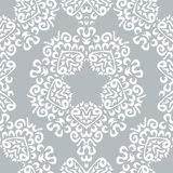 Seamless background made of exotic pattern in grey and white col Royalty Free Stock Image