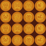 Seamless background with Maya calendar named days and associated glyphs Royalty Free Stock Image