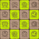 Seamless background with Maya calendar named days and associated glyphs Stock Photo