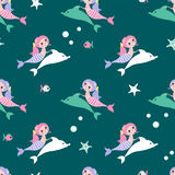 Seamless background with mermaid and dolphin vector illustration
