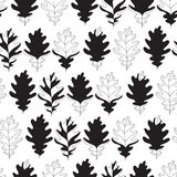 Seamless background with monochromatic oak autumn leaves. Vector illustration. Stock Photos