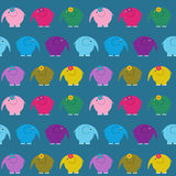 Seamless background with multi-colored bright cute elephants Stock Photos