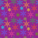 Seamless background with multi-colored Christmas snowflakes Stock Images