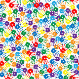 Seamless background with multi-colored handprints Stock Photo