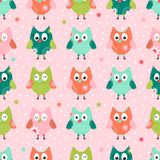 Seamless background with multi-colored owls. Seamless pattern with cute doodle owl on pink background. Children background. Vector illustration Royalty Free Stock Image