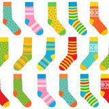 Seamless background of multi-colored socks with patterns and stripes stock illustration