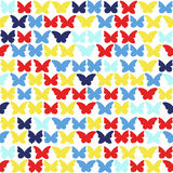 Seamless  background with multicolored butterflies. Stock Image