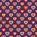 Seamless background with multicolored hearts Stock Image