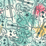 Seamless background with musical instruments on scribble background Royalty Free Stock Photo