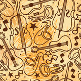 Seamless background with musical instruments on scribble background Stock Image