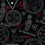 Seamless background with mystic symbols on black Stock Images