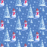 Seamless background on New Year s theme. A lot of snowmen and christmas tree blue. Royalty Free Stock Photo