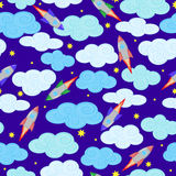 Seamless background with night cloudy skies, rockets and stars. Seamless pattern with rockets, clouds and stars on blue background Royalty Free Stock Image
