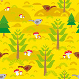 Seamless background with orange autumn mushrooms spruce trees birds Royalty Free Stock Photo