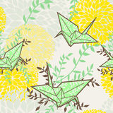 Seamless background with origami cranes and floral ornament Stock Photography