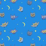 Seamless background with owls Stock Photos