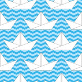 Seamless background with paper boats on the waves. For textiles, interior design, for book design, website background Stock Photos