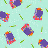 Seamless background pattern. With backpack and pencils Stock Photos