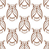 Seamless background pattern with brown owls Stock Photos