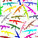 Seamless background pattern of colorful assault rifles Stock Image