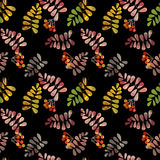 Seamless background pattern with colorful autumn leaves and berr Royalty Free Stock Images