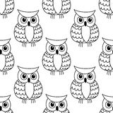 Seamless background pattern of a cute owl Stock Photos