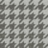 Geometrical patchwork pattern. Seamless background pattern. Geometrical Hounds-tooth pattern with imitation of a fabric texture Royalty Free Stock Images