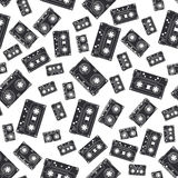 Seamless background pattern hipster style with audiocassette. Music. Sound. Retro. Magnetic tape. Analogue multimedia Royalty Free Stock Images