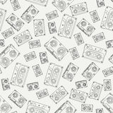 Seamless background pattern hipster style with audiocassette. Music. Sound. Retro. Magnetic tape. Analogue multimedia Stock Images