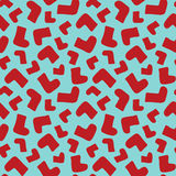 Seamless background pattern with red socks. Vector illustration Stock Photography