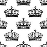 Seamless background pattern of a royal crowns. Useful for heraldry, wallpaper or textile Stock Photography