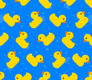 Seamless background pattern of yellow rubber ducks Stock Photos