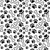 Seamless background - pet paw print and bone Royalty Free Stock Photos