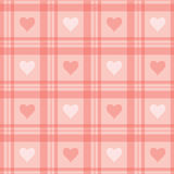 Seamless background. Pink checkered wallpaper with hearts. Royalty Free Stock Image