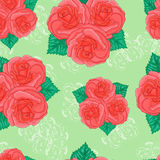 Seamless background. Pink roses on a green background. Stock Photo