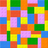 Seamless background with plastic toy blocks. Of different colors Royalty Free Stock Images