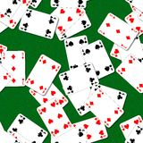 Seamless background with playing cards irregularly scattered on the green table Royalty Free Stock Photo
