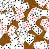 Seamless background playing cards randomly scattered on dark brown woody table Royalty Free Stock Image