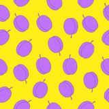 Seamless background of purple plums on a yellow background. Pattern for wrapping paper, fabric, background Stock Photography