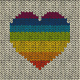 Seamless background with rainbow knitted heart Stock Photo