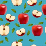 Seamless background with red apples and leaves. Stock Images