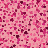 Seamless background with scattering of pink hearts Stock Photography