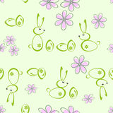 Seamless background with silhouettes of Easter bunnies. Seamless bright green background of Easter bunnies and flowers Royalty Free Stock Images
