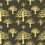 Seamless background of silhouettes of trees. Royalty Free Stock Photography