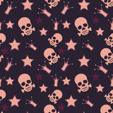 Seamless background with skulls, crowns and stars Stock Photography